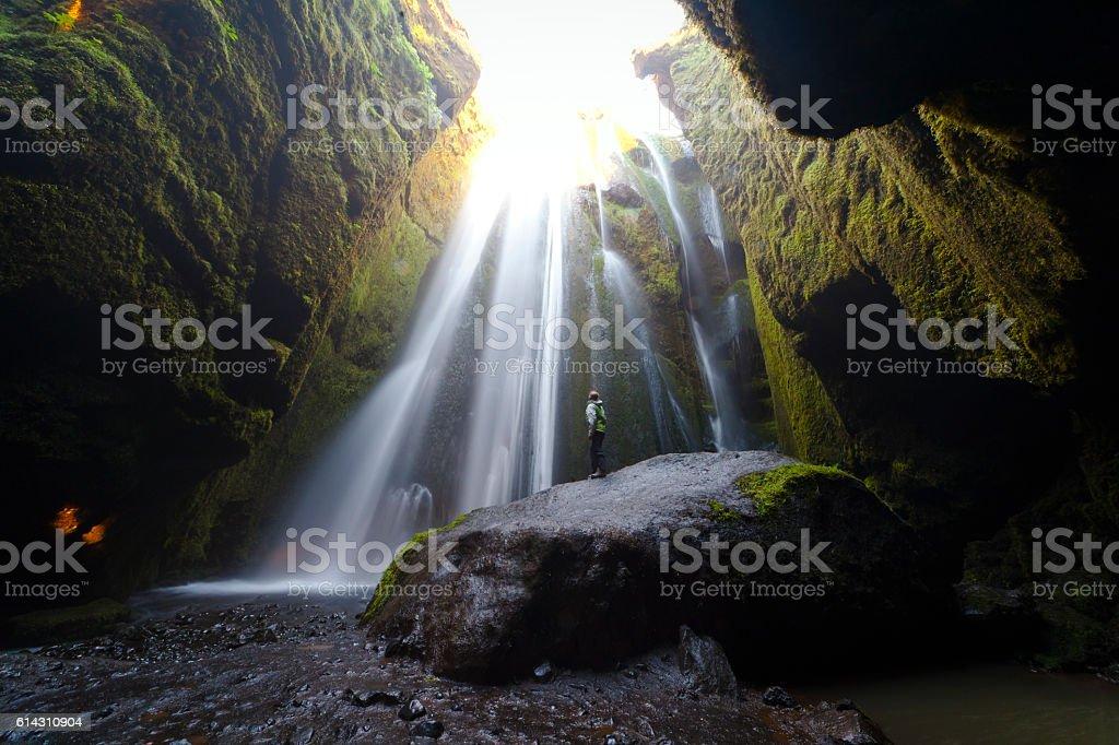Woman admiring Gljúfrafoss waterfall stock photo