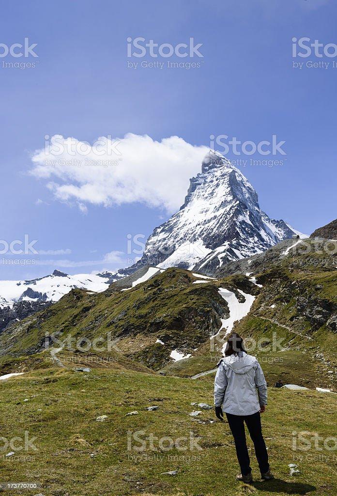 Woman admiring stark beauty of the Matterhorn royalty-free stock photo