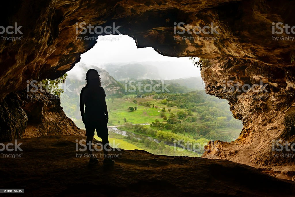 Woman admiring the view from Window Cave in Puerto Rico. stock photo