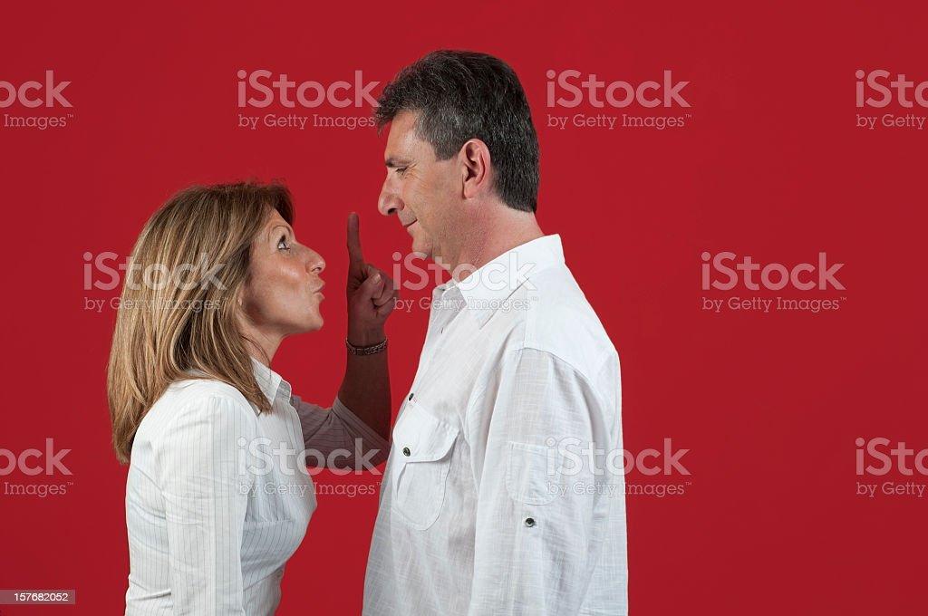 Woman admonishing her husband royalty-free stock photo