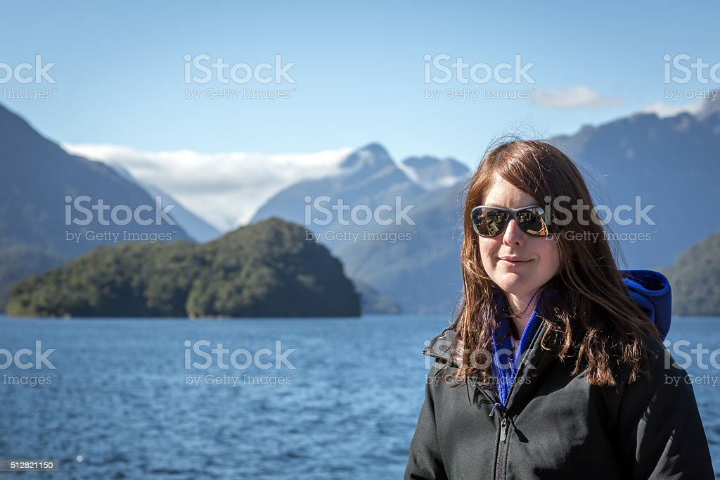 Woman Adventurer in Milford Sound, South Island, New Zealand stock photo