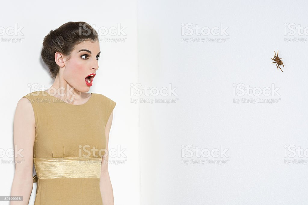 Woman afraid of spider stock photo