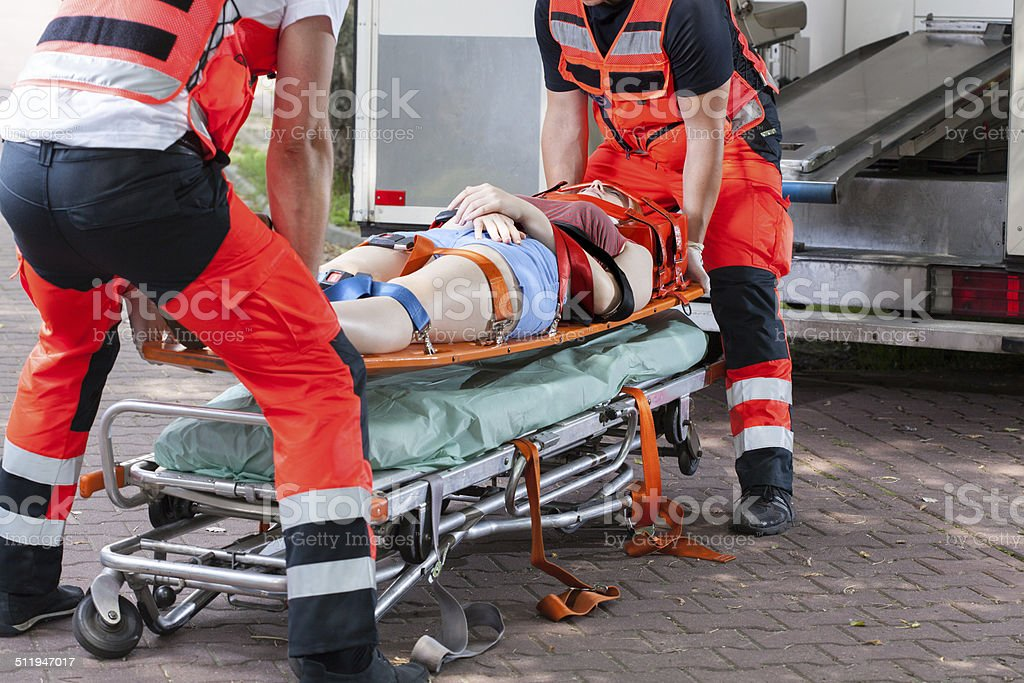 Woman after accident on the stretcher stock photo