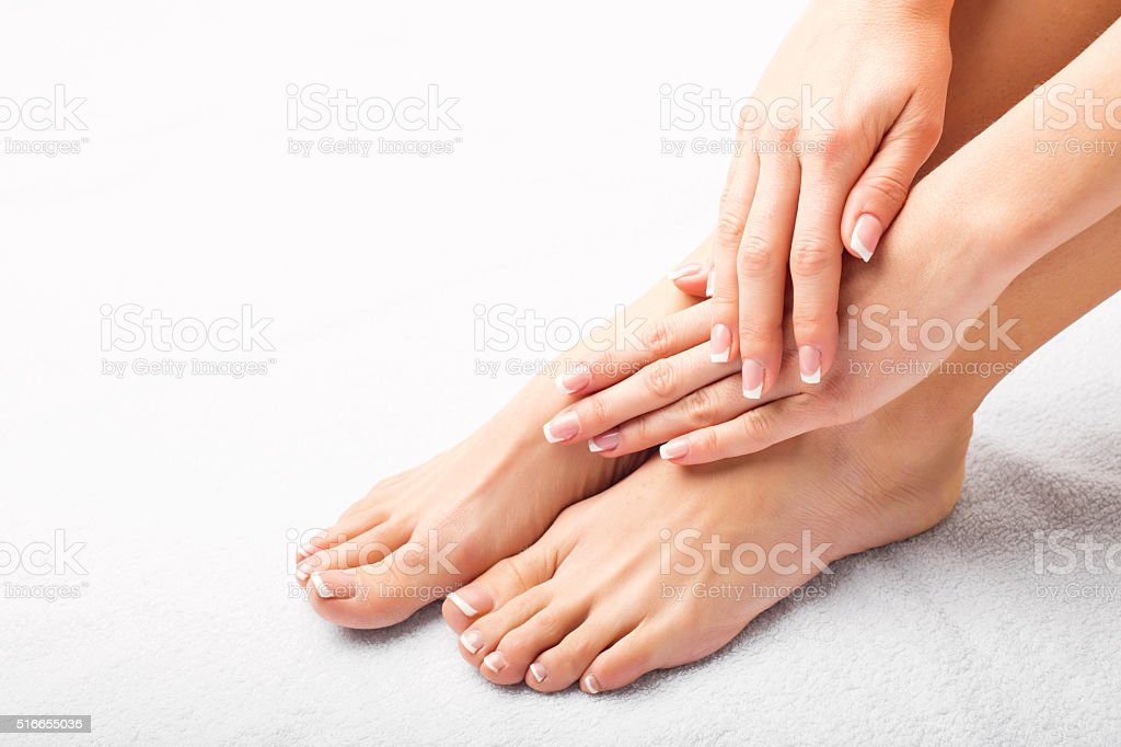 Woman after manicure and pedicure stock photo