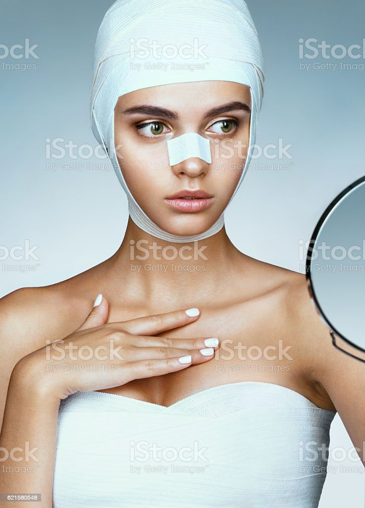 Woman after plastic surgery stock photo