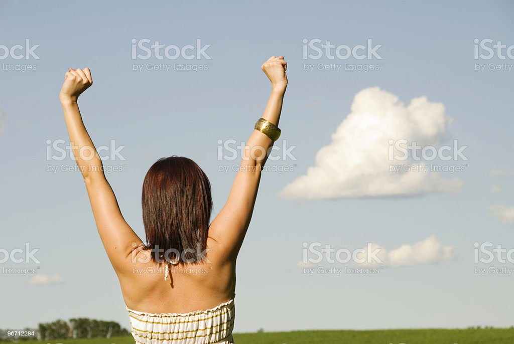 Woman against blue sky stock photo