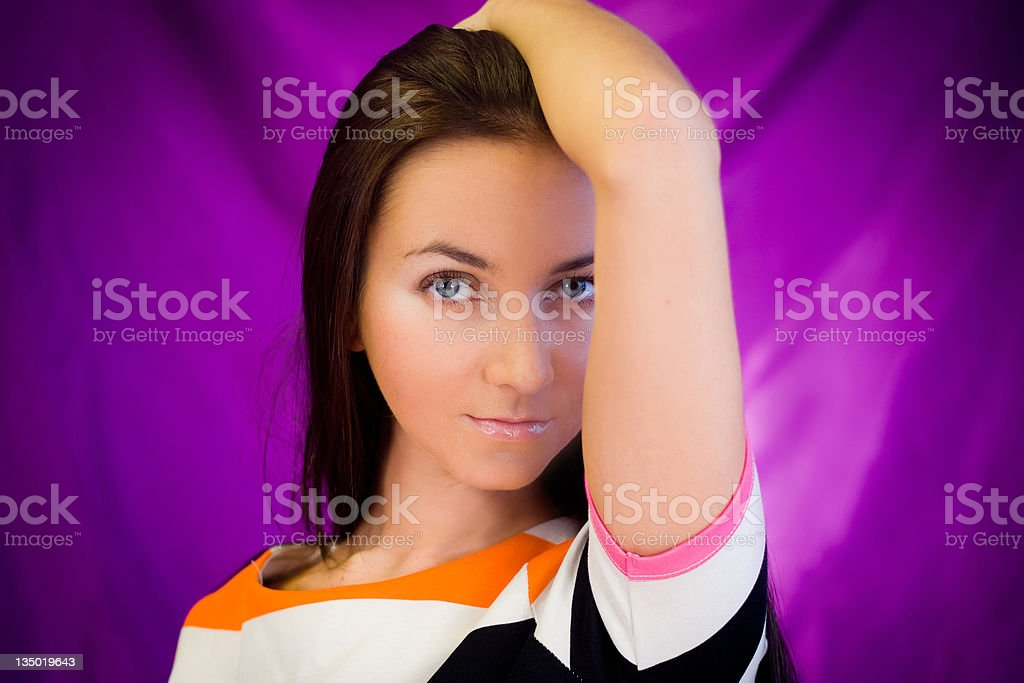 Woman against purple background stock photo