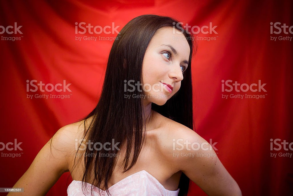 Woman against red background stock photo