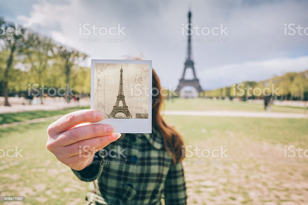 Woman against the Eiffel tower showing photo stock photo