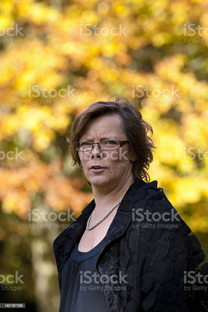 Woman against trees royalty-free stock photo