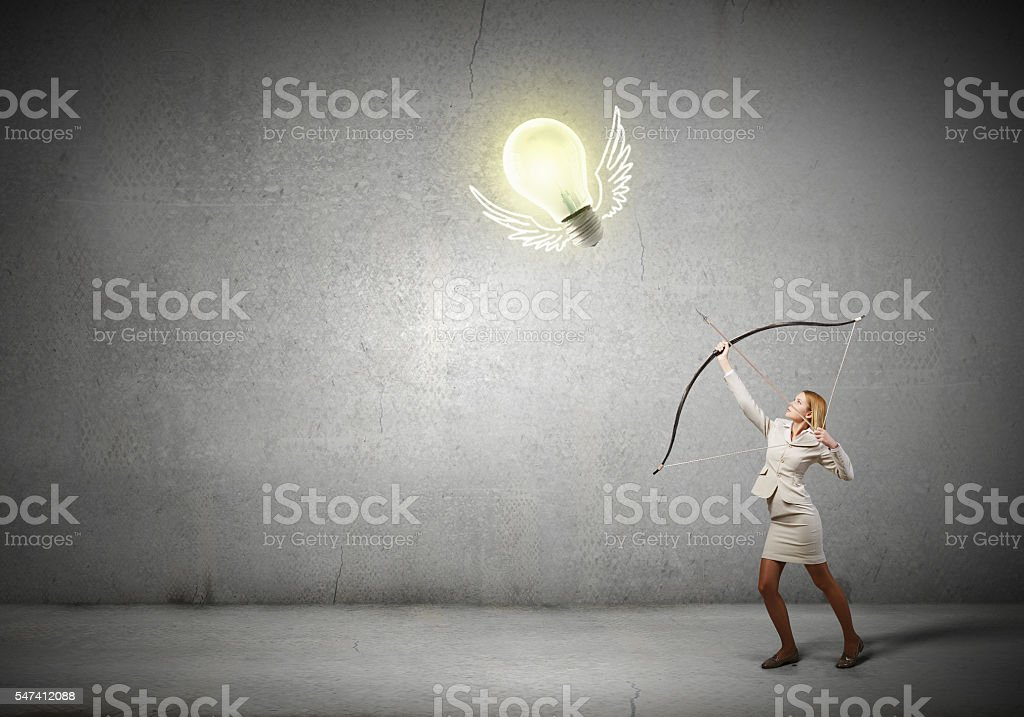 Woman aiming her goal . Mixed media stock photo