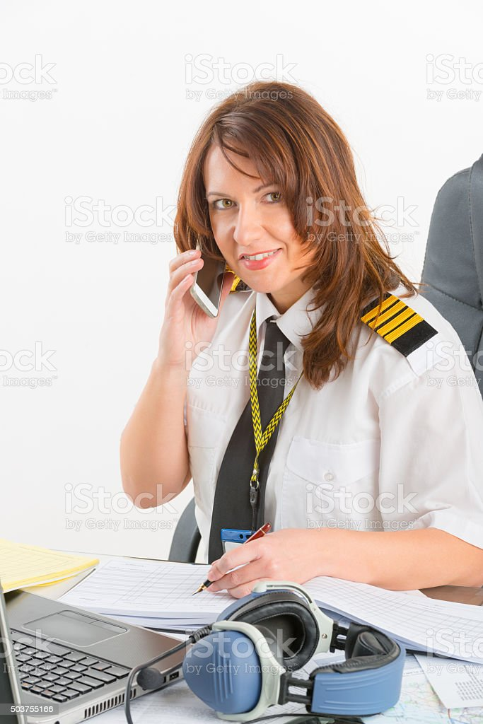 Woman airline pilot at the office stock photo