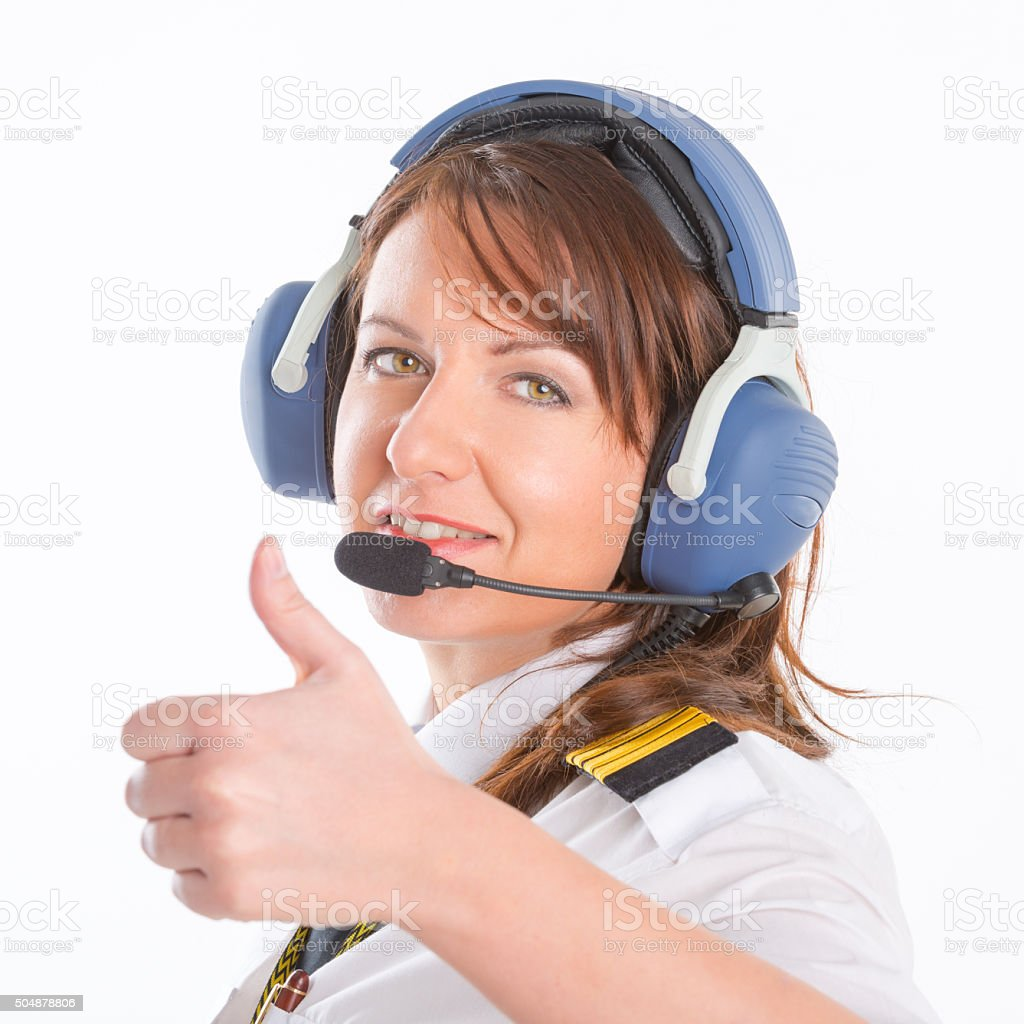 Woman airline pilot with headset stock photo