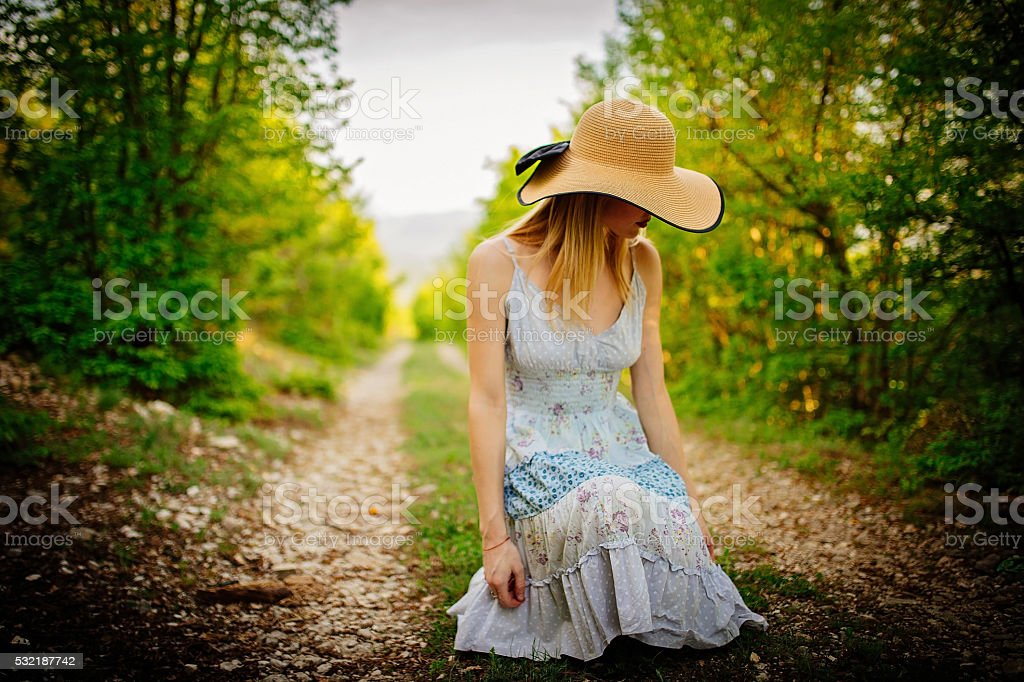 Woman alone in the forest stock photo