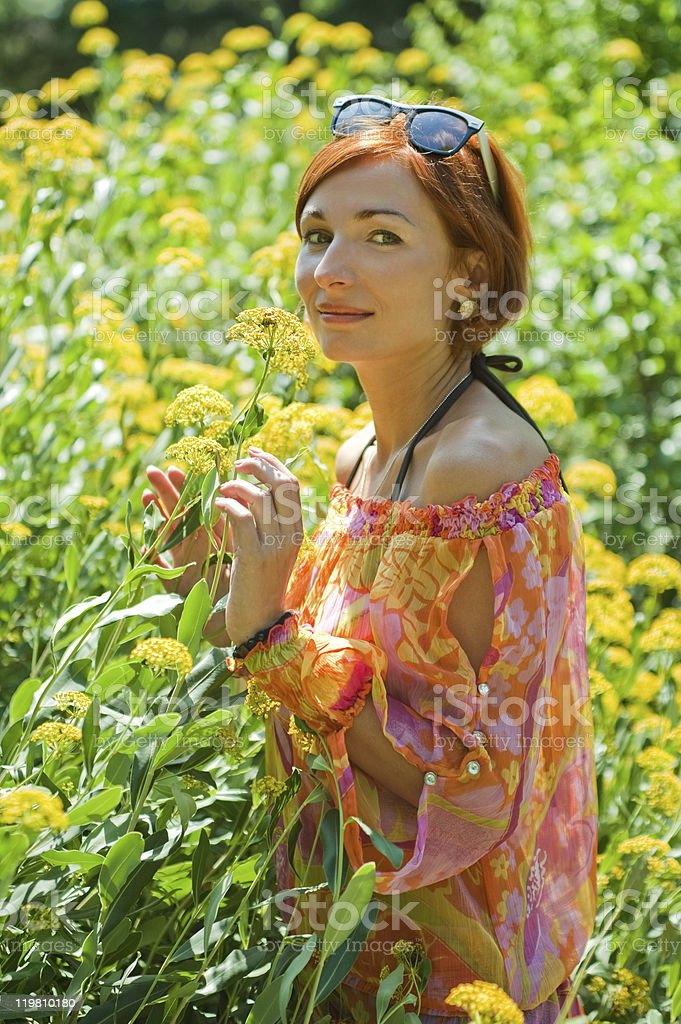 Woman among the flowers stock photo
