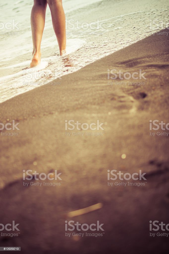 A woman and a beach. stock photo
