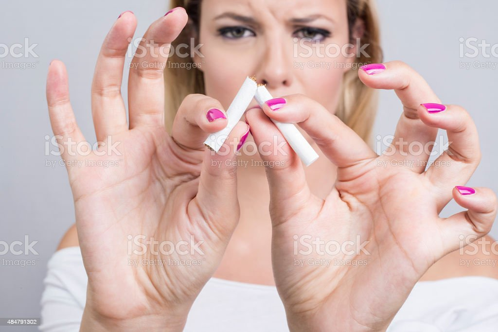 Woman and a cigarette stock photo