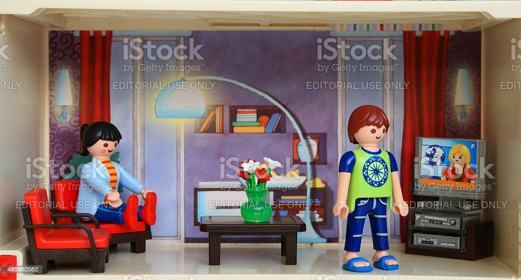 Woman and a man staying at home doing everyday chores. stock photo