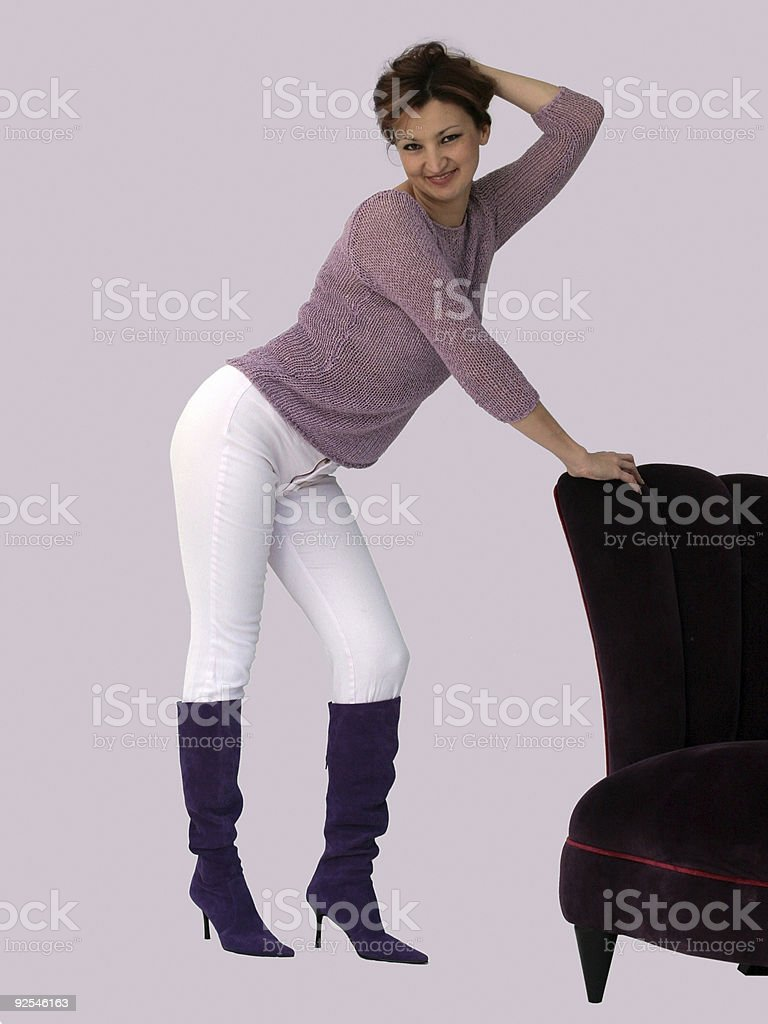 Woman and a purple chair royalty-free stock photo