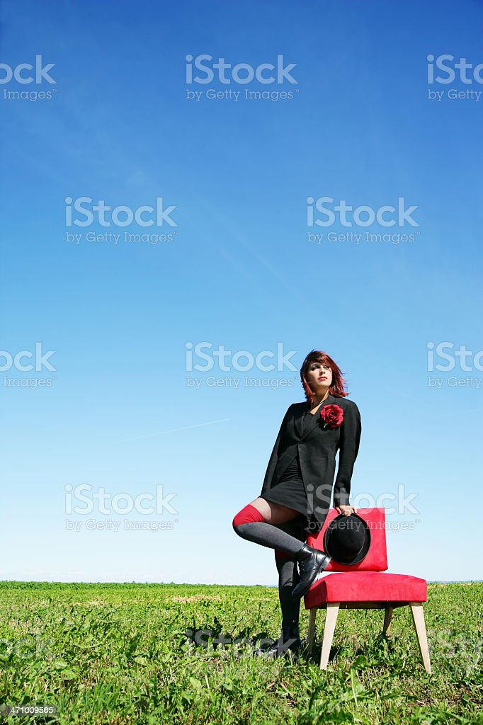 woman and a red chair royalty-free stock photo