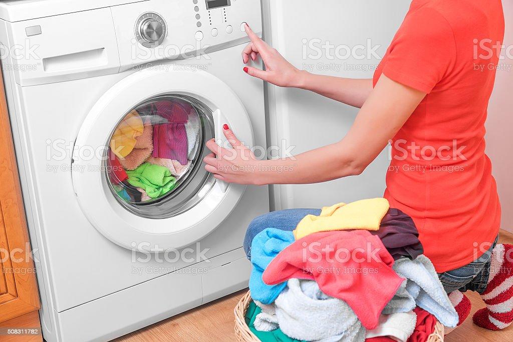 Woman and a washing machine stock photo