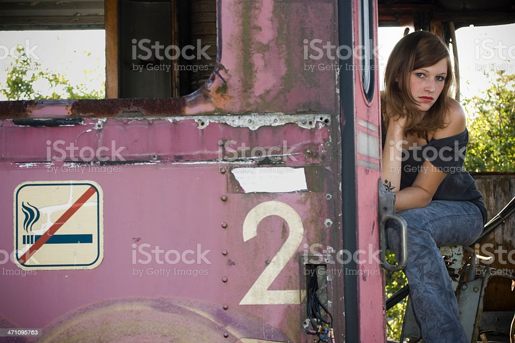 Woman and abandoned waggon stock photo