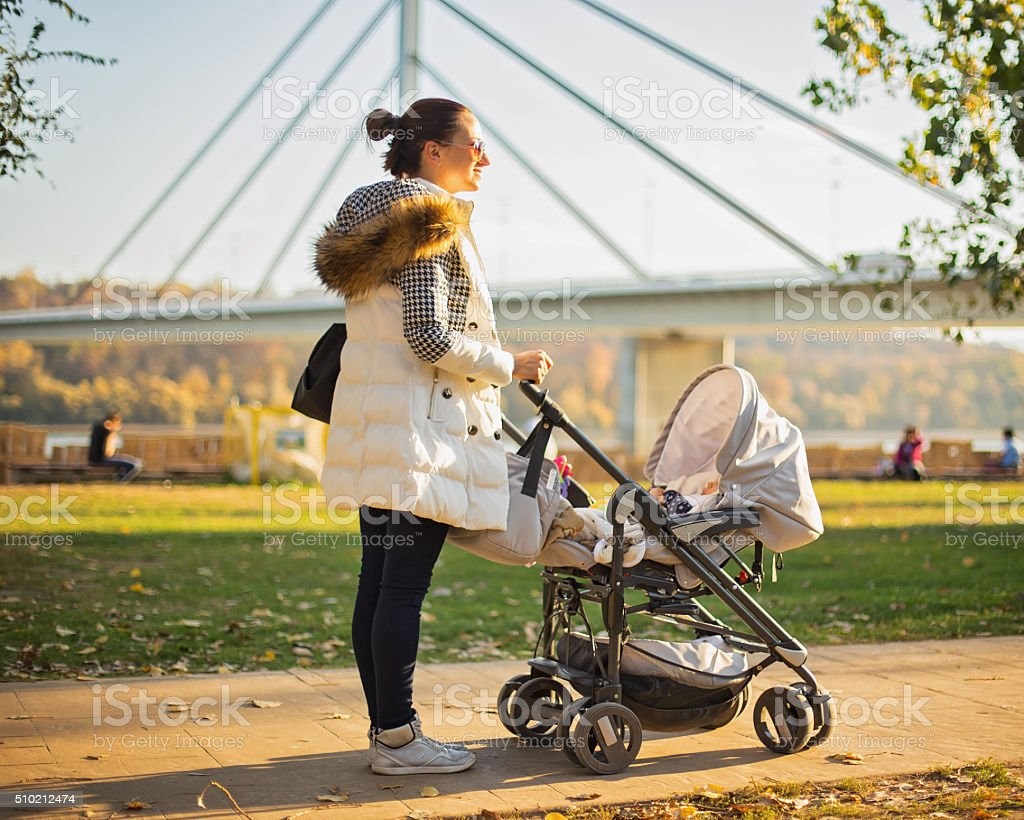 Woman and baby going for a walk stock photo