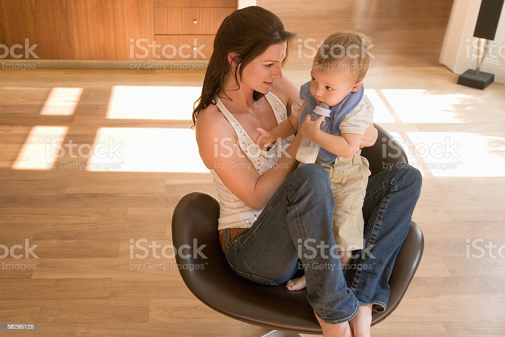 Woman and baby in a chair stock photo