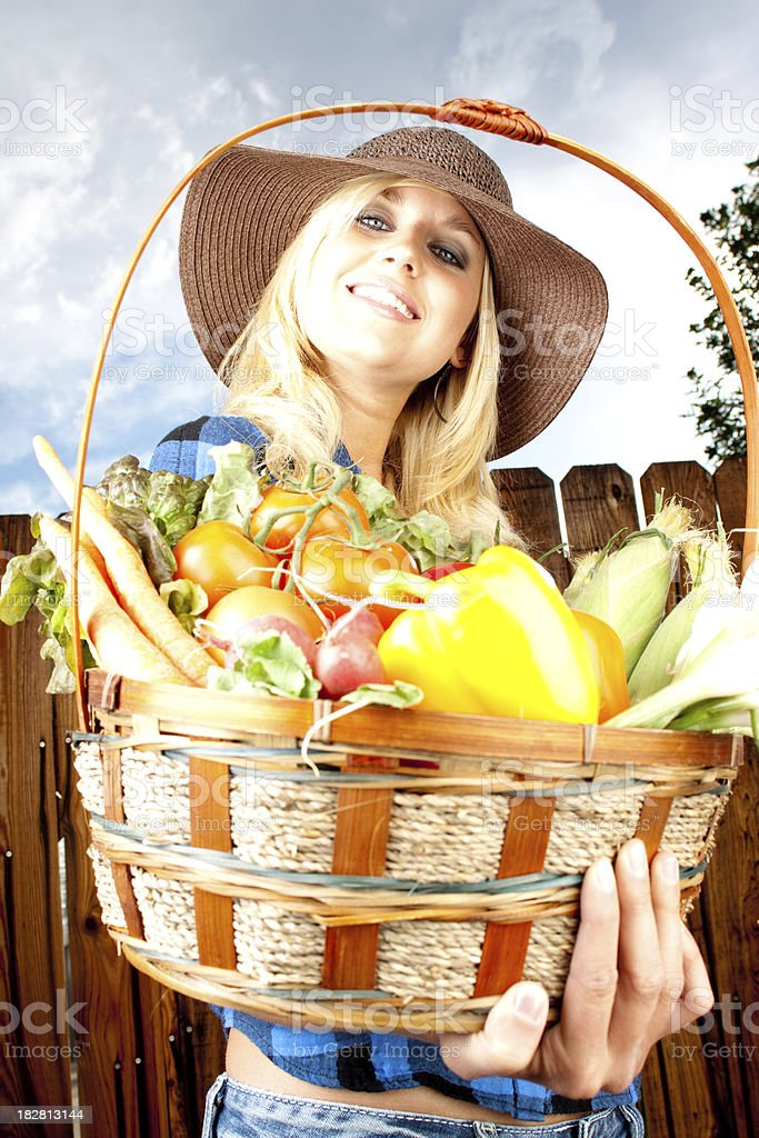 Woman and basket of fresh garden vegtables royalty-free stock photo