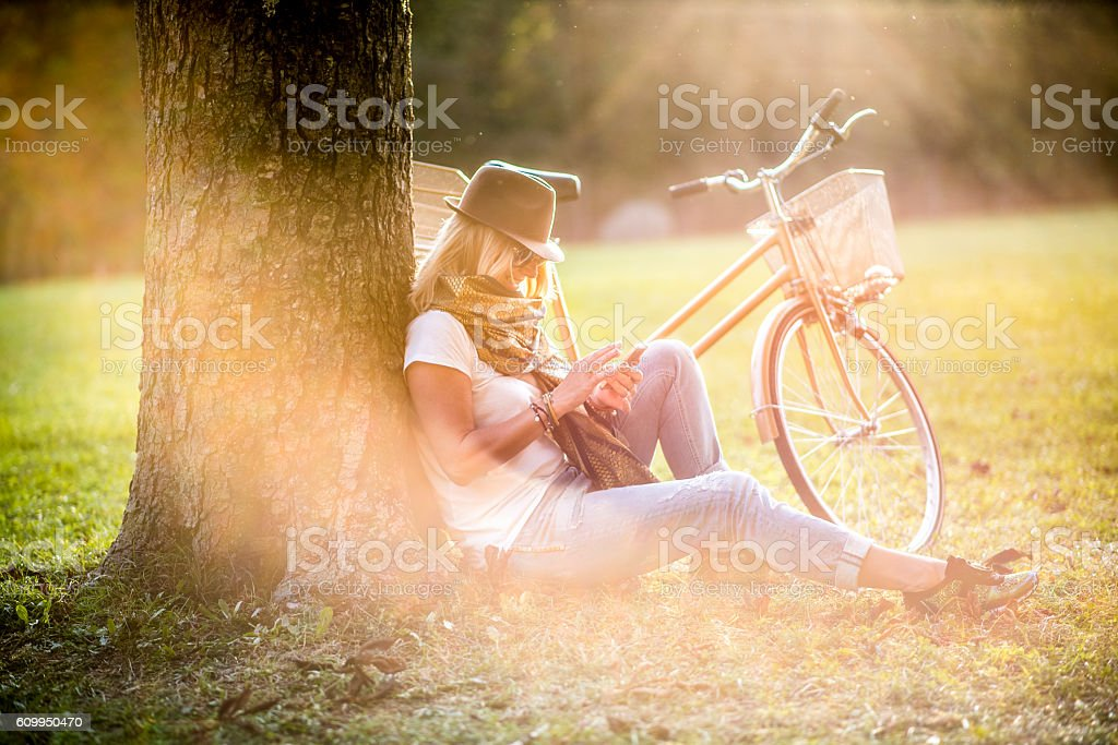 Woman and bicycle on autumn day stock photo