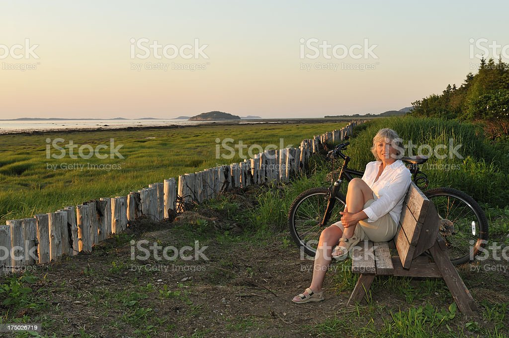 Woman and bike at sunset royalty-free stock photo