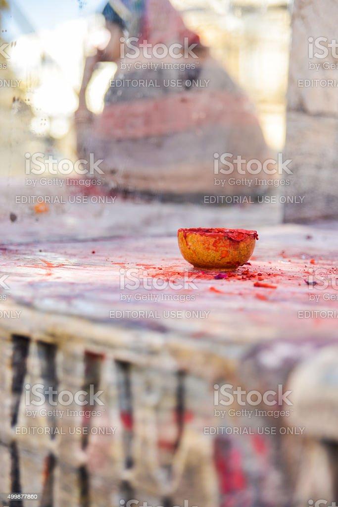 Woman and Bindi Paste Pot at Hindu Temple, India stock photo