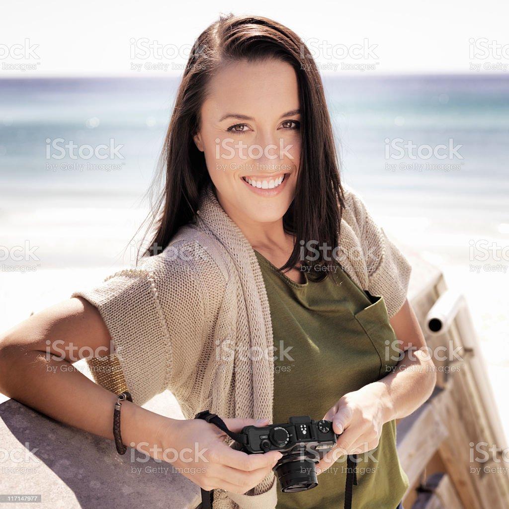 Woman and Camera at Beach royalty-free stock photo