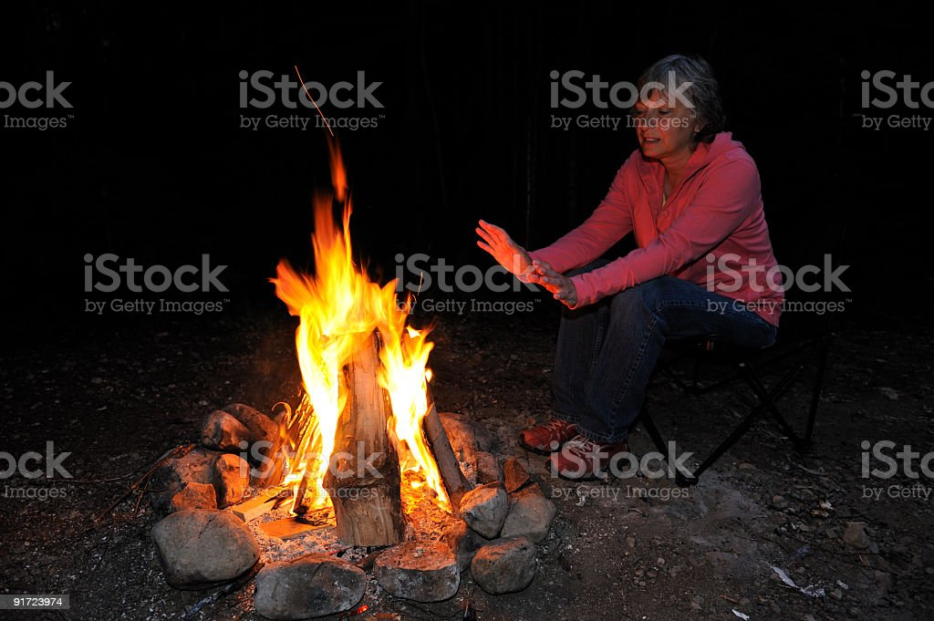 Woman and campfire royalty-free stock photo