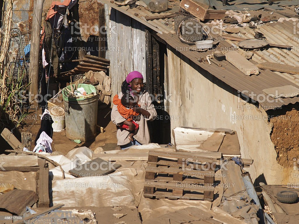 Woman and child in slum town. royalty-free stock photo