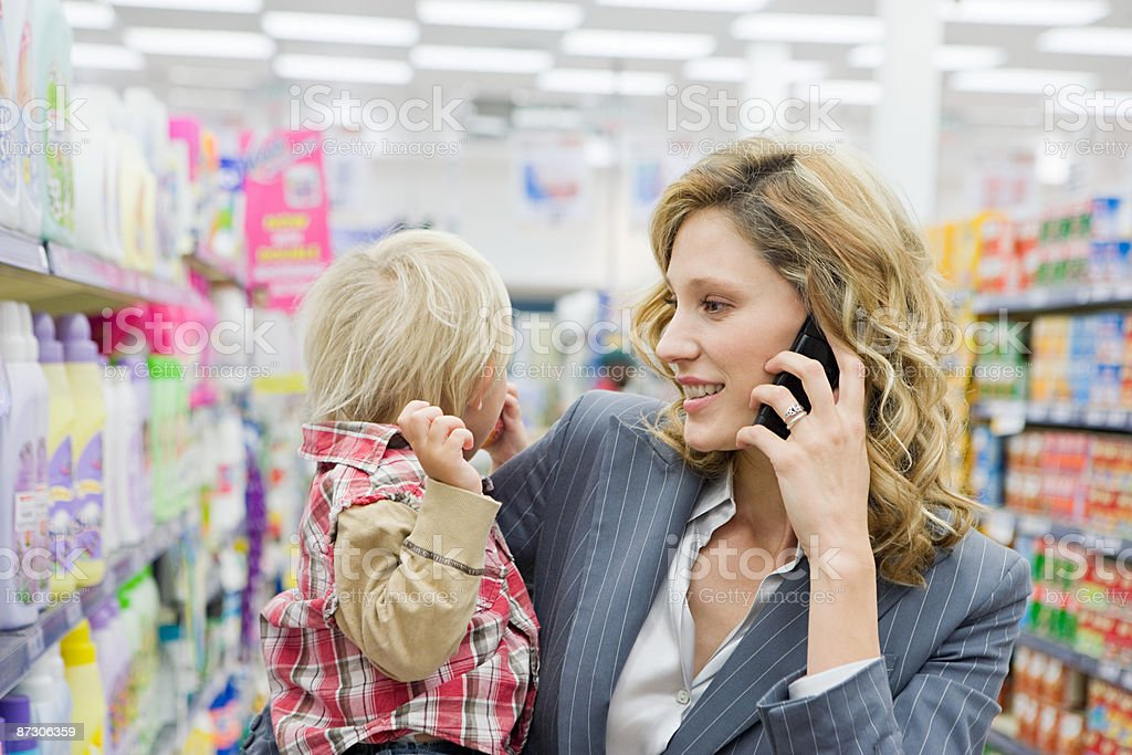 Woman and child in supermarket stock photo