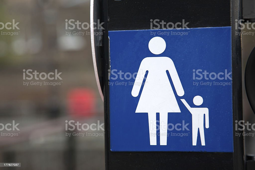 Woman and Child on Sign royalty-free stock photo