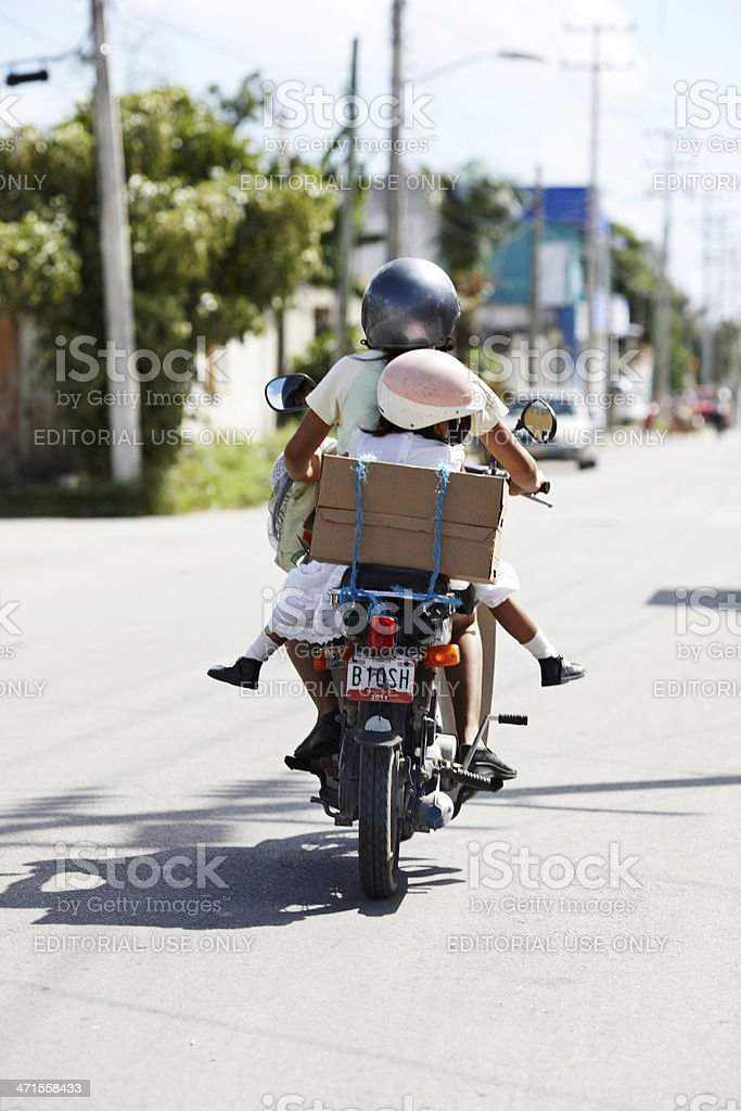 Woman and child travelling on motorcycle stock photo