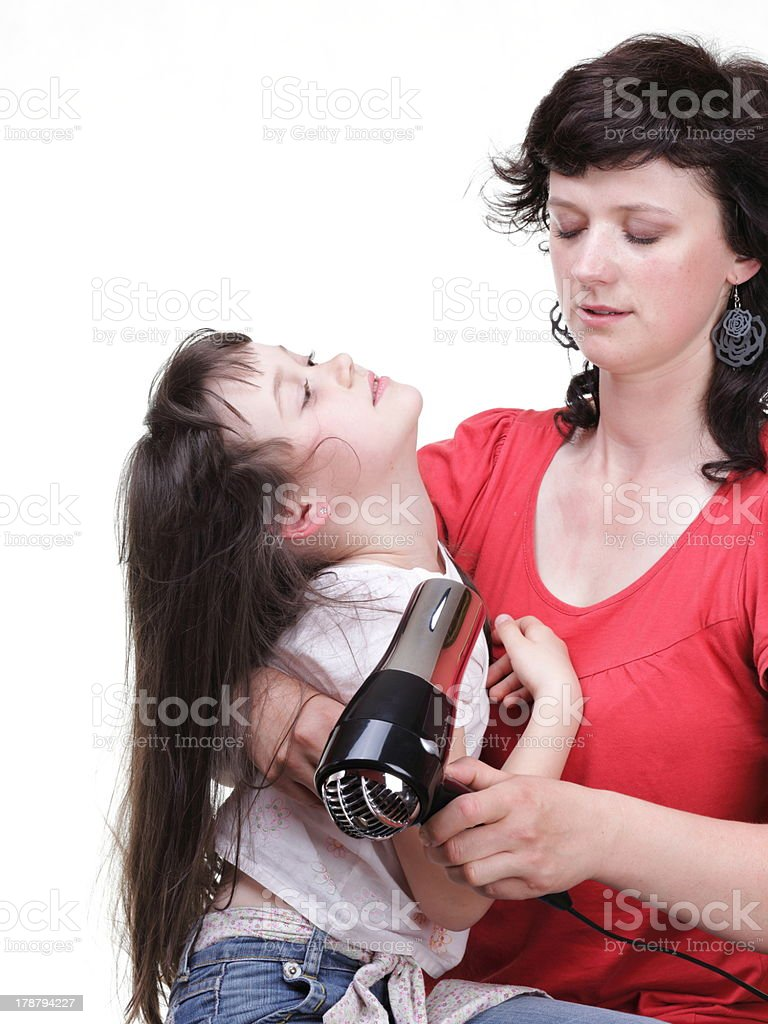 woman and daughter Little girl dries hair isolated royalty-free stock photo