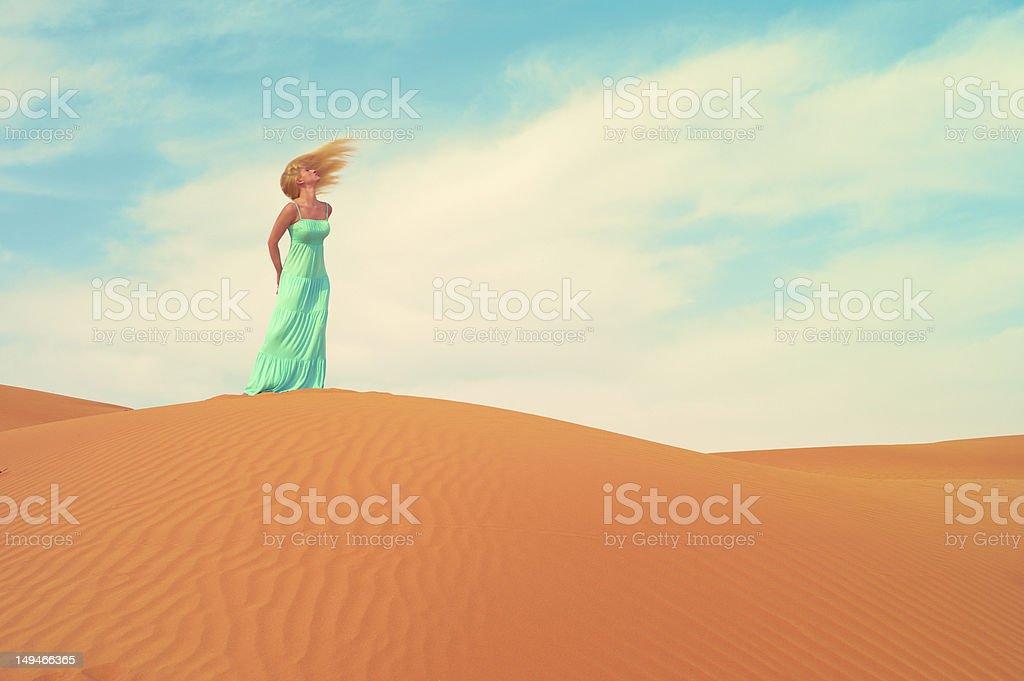 Woman and desert. UAE royalty-free stock photo