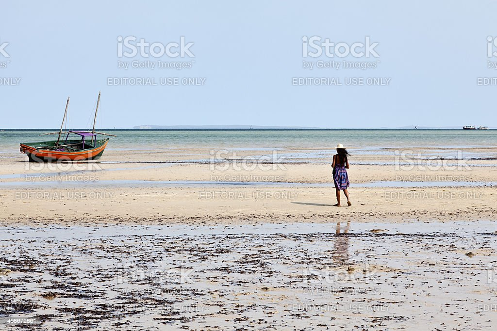 Woman and Dhow stock photo
