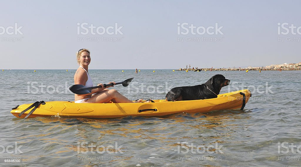 woman and dog on a kayak royalty-free stock photo