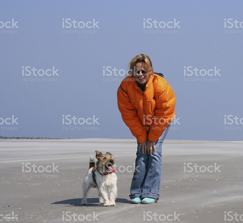 Woman and dog on empty beach 2 royalty-free stock photo