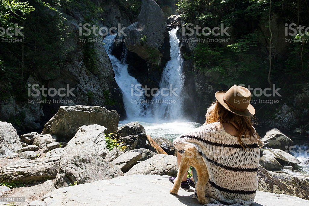 Woman and Dog View Double Waterfall stock photo