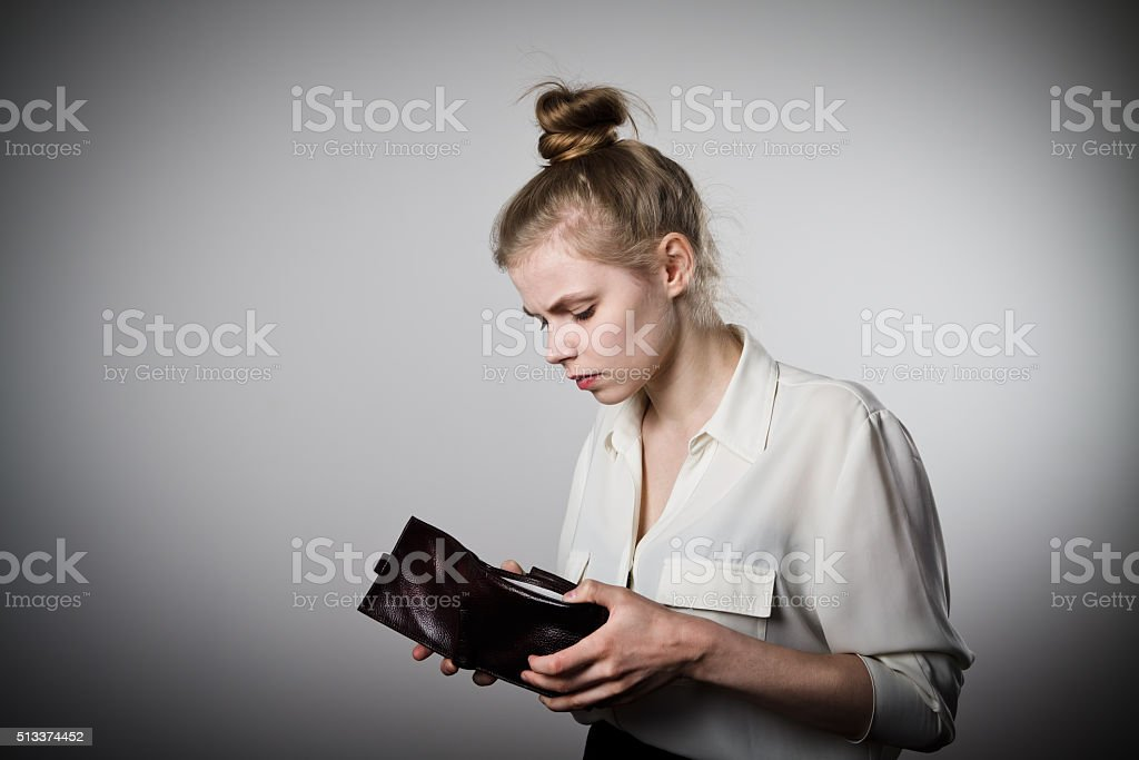 Woman and empty wallet stock photo