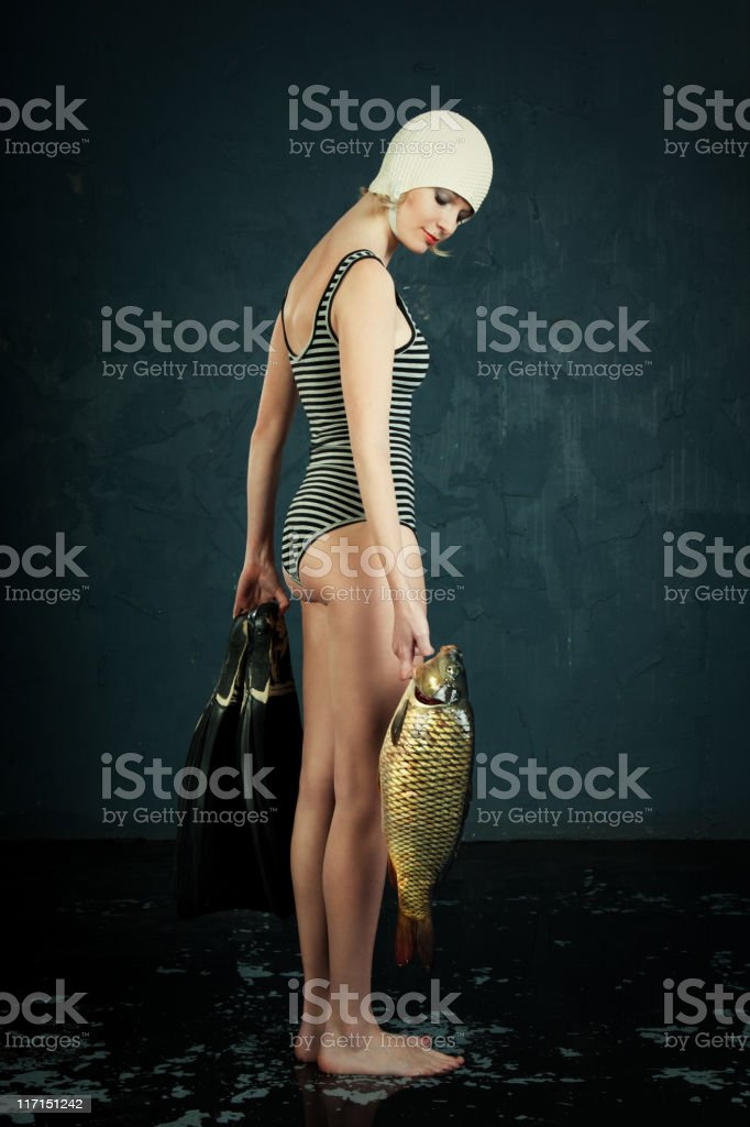 Woman and fish stock photo
