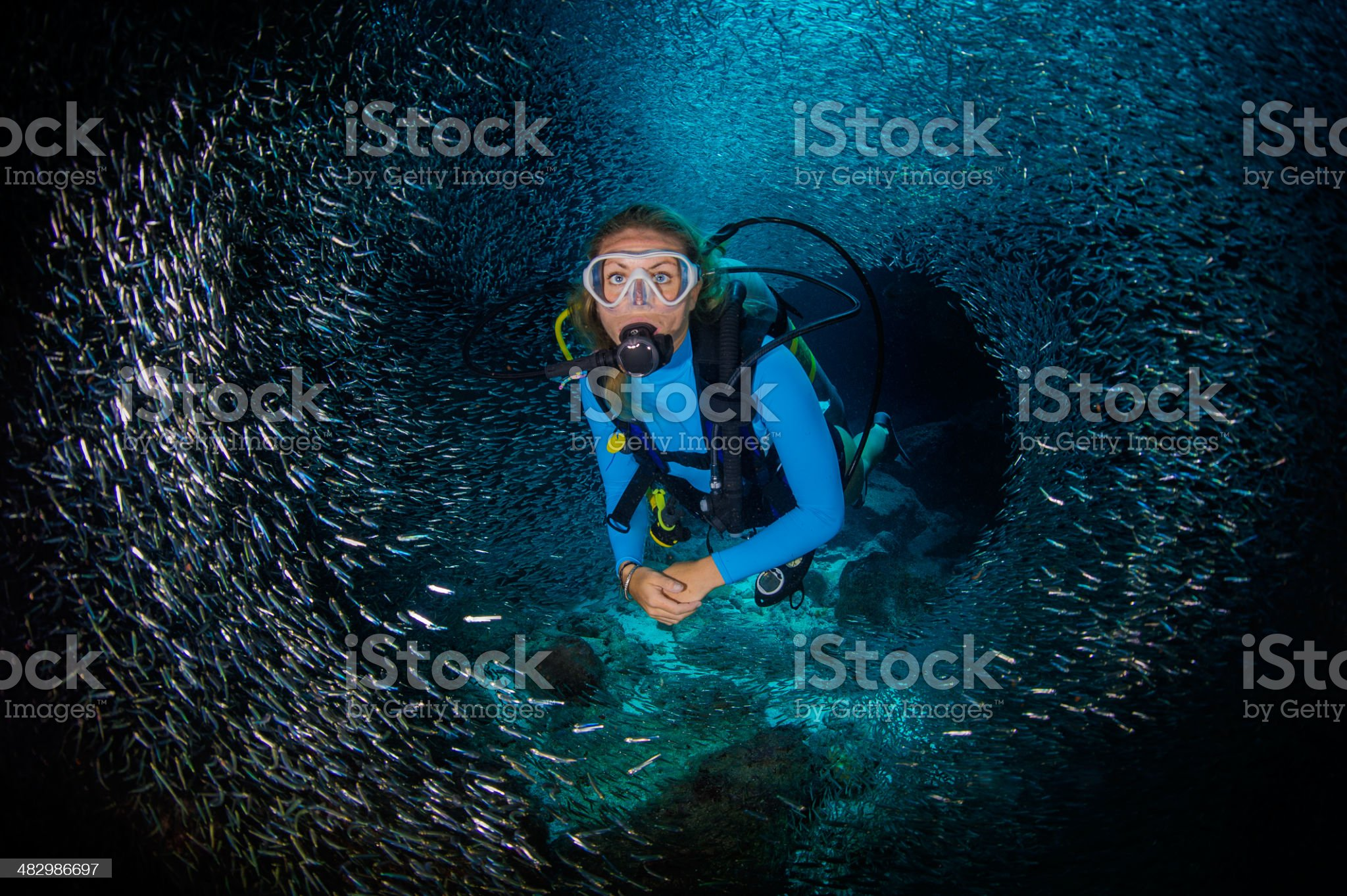Woman and fishes royalty-free stock photo