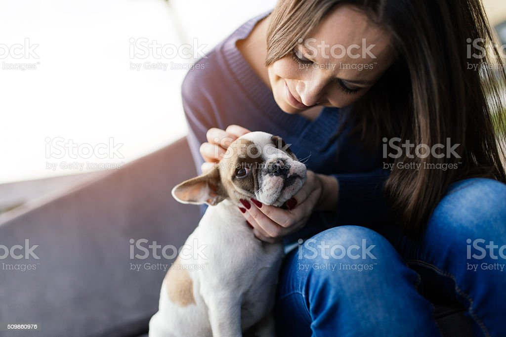 Woman and French bulldog outdoors stock photo