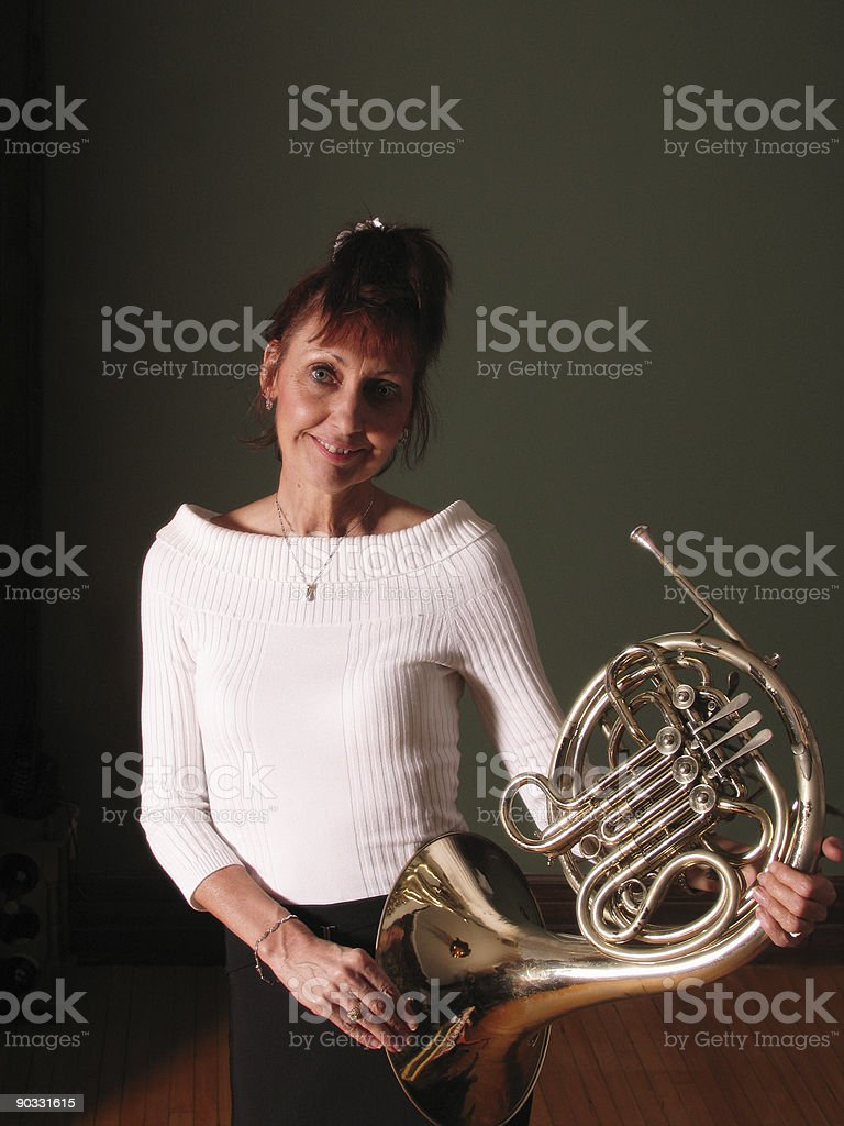 Woman and french horn royalty-free stock photo