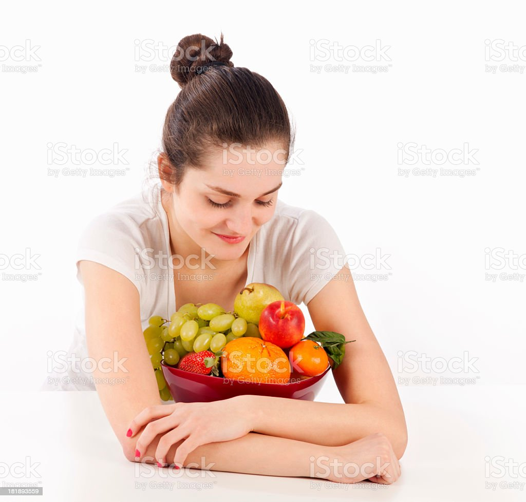 Woman and full bowl of fruits royalty-free stock photo